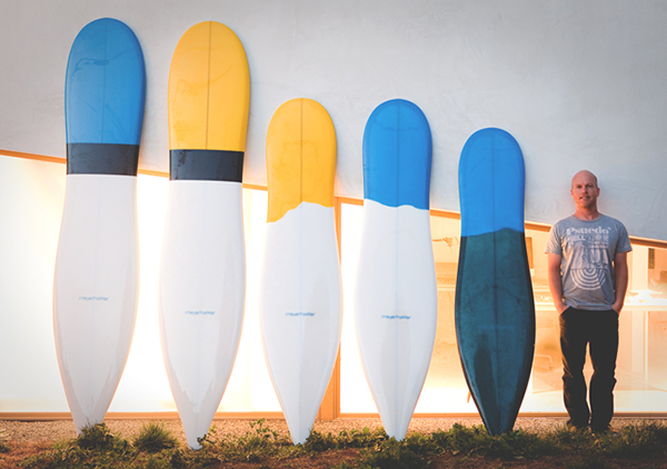 Photo of Thomas Meyerhoffer with surfboard designs